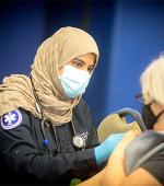 Marj Alhumayed, EMS student volunteer at vaccine clinic